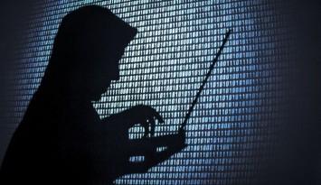 Computer hacker silhouette. Blue binary code background.  Seattle office.
